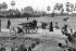 Cambodian War. People picking up shell cases on road number 4. Cambodia, 1975. © Françoise Demulder / Roger-Viollet