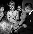 Jean Lefebvre, Catherine Deneuve, Roger Vadim et Robert Dalban. Paris, Club Saint-Hilaire, 1962. © Roger-Viollet