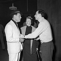 "Shooting of ""Folies-Bergère"", film by Henri Decoin (1956). Eddie Constantine, Zizi Jeanmaire and Roland Petit. France, on February 21, 1956. © Alain Adler / Roger-Viollet"