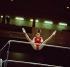 Nadia Comaneci (née en 1961), gymnaste roumaine, aux barres asymétriques, lors des championnats d'Europe de gymnastique artistique. Prague (Tchécoslovaquie), 13-14 mai 1977.  © Schlage/Ullstein Bild/Roger-Viollet