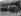 """Sous-officiers des """"Grenadier Guards"""", régiment d'infanterie de l'armée britannique, portant le cercueil de la reine Alexandra de Danemark (1844-1925), épouse du roi Edouard VII. Derrière : le roi George V, la reine Mary de Teck, la princesse Victoria et d'autres membres de la famille royale britannique. Sandringham (Angleterre), 26 novembre 1925. © PA Archive / Roger-Viollet"""