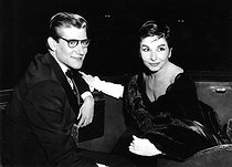 "Yves Saint Laurent (1936-2008), French fashion designer, and Zizi Jeanmaire (1924-2020), French dancer and music hall artist, during the opening of Ballets de Paris by Roland Petit in ""Cyrano de Bergerac"". London (England), Adelphi Theatre, 18 November 1959. © TopFoto / Roger-Viollet"
