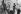 Jeunes réparant une 2CV dans le quartier de la Goutte d'Or, rue Polonceau. Paris (XIIème arr.), 1973. Photographie de Léon Claude Vénézia (1941-2013). © Léon Claude Vénézia/Roger-Viollet