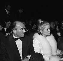 Eddie Barclay (1921-2005), French music producer, with Catherine Deneuve (born in 1943), French actress, at the Olympia. Paris, March 1964. © Studio Lipnitzki / Roger-Viollet