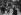 Homme portant une hotte de légumes. Halles centrales de Paris, 1908. © Jacques Boyer/Roger-Viollet