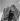Firemen climbing a turntable ladder. Paris, 1960's. © Gaston Paris / Roger-Viollet