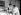 Irène et Frédéric Joliot-Curie, physiciens français, travaillant à l'irradiation d'une lame métallique pour radioactiver sa surface, dans leur laboratoire de l'Institut du radium, en 1934. © Albert Harlingue/Roger-Viollet