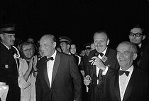 "Bourvil, Terry-Thomas and Louis de Funès at the première of ""La Grande Vadrouille"" by Gérard Oury at the Cannes Film Festival. France, 1966.    © Roger-Viollet"