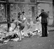 World War II. Liberation of Paris. Children tearing off and burning posters of the Occupation. Paris, August 1944. © LAPI/Roger-Viollet