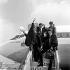 """Ringo Starr, Paul McCartney, John Lennon et George Harrison, membres du groupe de rock anglais """"The Beatles"""" revenant d'une tournée en Australie. Londres (Angleterre), 2 février 1964. © PA Archive/Roger-Viollet"""
