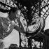 Mirror effect under the Eiffel Tower. Anne Doat (born in 1936), French actress. Paris (VIIth arrondissement), circa 1960. © Gaston Paris / Roger-Viollet