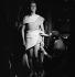 """Paul Cambo (1908-1978), French actor, during a rehearsal of """"La Guerre de Troie n'aura pas lieu"""", play by Jean Giraudoux. Paris, Théâtre de l'Athénée, 1937. © Gaston Paris / Roger-Viollet"""