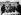 """Les """"Sex Pistols""""  groupe de punk anglais. De g. à dr. : Johnny Rotten, Steve Jones, Paul Cook, Sid Vicious et leur manager Malcom McLaren signant un nouveau contrat devant le palais de Buckingham. Londres (Angleterre), 10 mars 1977. © PA Archive/Roger-Viollet"""