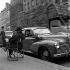 Peugeot 203 taxi stopped at a taxi rank. Paris, quai Saint-Michel, 1954. © Roger-Viollet