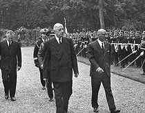 The General de Gaulle and the King Mohammed Zahir Shah of Afghanistan, reviewing some French troops. On the left: Pierre Messmer. Paris, garden of the Elysee palace, on June 5, 1965.  © Roger-Viollet