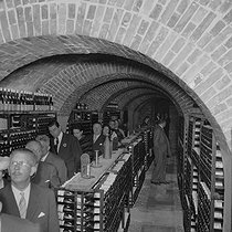 Inauguration of the cellars of the Eiffel Tower. Paris, on September 30, 1957. © Roger-Viollet