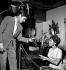"""Tournage du film """"Faibles femmes"""" de Michel Boisrond. Alain Delon et Pascale Petit. Studios de Boulogne-Billancourt (Hauts-de-Seine), 16 octobre 1958. © Roger Berson / Roger-Viollet"""