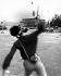 Manifestant lançant une pierre sur les blindés rassemblés sur la place Tian'anmen. Pékin (Chine), 4 juin 1989.  © Sean Ramsay / The Image Works / Roger-Viollet