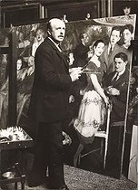 "Jacques-Emile Blanche (1861-1942), French painter, painting ""Le Groupe des Six"", in his studio. Paris, around 1920. Photograph by Louis Sylvestre.  © Louis Silvestre / Collection Harlingue / Roger-Viollet"