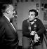 Bruno Coquatrix (1910-1979), directeur de l'Olympia et Richard Anthony (1938-2015, chanteur français. Paris, Olympia, décembre 1961. © Studio Lipnitzki / Roger-Viollet