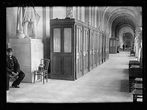 "Eve of the signing of the Treaty of Versailles. Telephone booths for the press. Palace of Versailles (France), on June 27, 1919. Photograph published in the newspaper ""Excelsior"" on Sunday, June 29, 1919. © Excelsior - L'Equipe / Roger-Viollet"