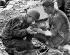 Guerre 1939-1945. Débarquement en Normandie. Médecin américain soignant un prisonnier allemand à Omaha Beach (Calvados), 6 juin 1944. © Roger-Viollet