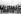 """Manifestants anti-gouvernementaux lisant des passages du """"Petit Livre rouge"""" du président communiste Mao Zedong en signe de protestation devant la maison du gouvernement. Macao (Chine), 7 décembre 1966. © TopFoto/Roger-Viollet"""