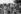 Famille de tziganes habitant un bidonville au pied de la préfecture Bobigny en construction. Bobigny (Seine-Saint-Denis), juillet 1970. Photographie de Léon Claude Vénézia (1941-2013). © Léon Claude Vénézia/Roger-Viollet