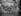 """Membres de la délégation révolutionnaire cubaine posant devant la fresque de José Vela Zanetti (""""La lutte de l'humanité pour une paix durable"""") dans le bâtiment des Nations Unies. De g. à dr. : un inconnu, Merquiades Lopez, Ramon Lopez, une inconnue, Rafael Ochoa, Dr. Manuel Bisbe, Camilo Cienfuegos, Juan Almeida Bosque, Pedro Miret Prieto, Nene Lopez, et Osvaldo Gonzalez. New York (Etats-Unis), février 1959.  © Saavedra / The Image Works / Roger-Viollet"""