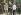 Guerre 1939-1945. Conférence de Potsdam. Winston Churchill, Harry Truman et Joseph Staline se serrant la main devant le château Cecilienhof. Derrière Churchill, son interprète, le Major Arthur Birse. Potsdam (Allemagne), 25 juillet 1945. Photo colorisée. © Ullstein Bild/Roger-Viollet