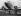 M. H. Gooding, directeur de l'aéroport, Anthony Fokker (1890-1939), pilote et constructeur d'avions néerlandais, M. Parmentier et M. Prins, observant un avion de la London Continental Airlines. Aéroport de Gravesend (Angleterre), 19 janvier 1935. © Imagno/Roger-Viollet