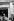 Maurice Chevalier dévoile la plaque commémorative de la naissance d'Edith Piaf. Paris, 1965. © Noa / Roger-Viollet