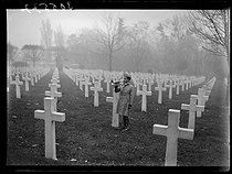 "Young boy playing the trumpet at the American military cemetery of Montfaucon, in memory of the soldiers who died during WWI. Montfaucon-d'Argonne (France), on November 11, 1939. Photograph from the collections of the newspaper ""Excelsior"". © Excelsior - L'Equipe / Roger-Viollet"