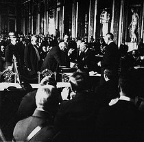 Georges Clemenceau signing the Treaty of Versailles in the Hall of Mirrors. June 28, 1919.  © Roger-Viollet