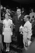 Prince Rainier III and Princess Grace of Monaco presenting the Monaco Grand Prix Cup to Stirling Moss, British racing driver. Monaco (Principality of Monaco), 1960. © Roger-Viollet