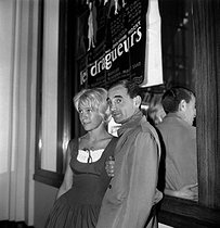 "Nicole Berger (1934-1967), French actress, and Charles Aznavour (1924-2018), Armenian-born French singer-songwriter and actor, attending the premiere of ""Les Dragueurs"", film by Jean-Pierre Mocky, 1959. © Roger-Viollet"