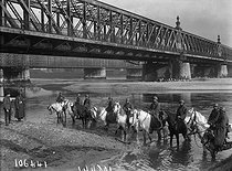 World War One. French Spahis taking their horses to drink in the river Rhine, in front of the Kehl bridge. Strasbourg (France), November 1918. © Maurice-Louis Branger/Roger-Viollet