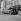 Déménagement : arrivée de l'agence LAPI, rue de Seine. En arrière-plan, vitrine de l'agence Roger-Viollet. Paris (VIème arr.), avril 1976. © Collection Roger-Viollet / Roger-Viollet