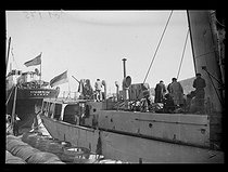 """Spanish Civil War (1936-1939). """"La Retirada"""". French sailors disarming a Spanish coastguard ship in the port of Port-Vendres (France), on January 29, 1939. Photograph from the Excelsior newspaper. © Excelsior - L'Equipe / Roger-Viollet"""