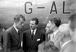 Maurice Herzog, alpiniste et homme politique français, accueillant au Bourget, les vainqueurs de l'Everest. De gauche à droite : Sir Edmund Hillary, Maurice Herzog, Marcel Ichac, docteur J. Carle. 22 juillet 1953.  © Roger-Viollet
