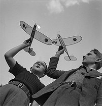 Boys and their toy airplanes. France, 1940's. © Gaston Paris / Roger-Viollet