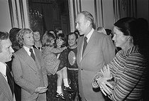 Christmas celebration at the Elysee Palace. Claude François (1939-1978), Egyptian-born French singer, talking to Valéry Giscard d'Estaing (born in 1926), President of the French Republic, and his wife Anne-Aymone (born in 1933). Paris (VIIIth arrondissement), December 1975. © Jacques Cuinières / Roger-Viollet