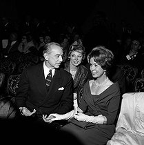 Danielle Darrieux, Micheline Boudet and Maurice Escande at a party of Charles Cros' academy. Paris, March 1960. © Claude Poirier / Roger-Viollet