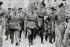 Guerre d'Espagne (1936-1939). Les généraux Emilio Mola y Vidal (1887-1937), Francisco Franco (1892-1975) et  Emilio Mola (1887-1937), marchant dans les rues de Burgos (Espagne), août 1936. Monistrol de Montserrat (Espagne), bibliothèque de l'abbaye. © Iberfoto / Roger-Viollet