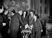 René Coty and his wife greeted at the Elysee Palace by the Auriol family, the day after the presidential election. From left to right : Mrs Auriol, Vincent Auriol, Mrs Coty, René Coty, Jacqueline Auriol and her children. Paris, on December 24, 1953. © Roger-Viollet