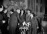 René Coty et son épouse reçus au Palais de l'Elysée par la famille Auriol, le lendemain de l'élection présidentielle. De gauche à droite : Mme Auriol, Vincent Auriol, Mme Coty, René Coty, Jacqueline Auriol et ses enfants. Paris, 24 décembre 1953. © Roger-Viollet