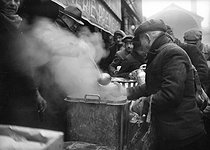 "World War II. Soup kitchen by the ""Entraide d'Hiver"" charity organization. Paris, January 1942. © Roger-Viollet"