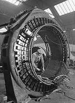 Sources of energy. Alsthom company : construction of a stator. Saint-Ouen (France), 1931-1934. Photograph by François Kollar (1904-1979). Paris, Bibliothèque Forney. © François Kollar/Bibliothèque Forney/Roger-Viollet