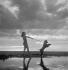 Woman on the beach. Deauville (Calvados, France), July 1950. © Studio Lipnitzki / Roger-Viollet