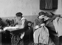 World War I. Women repairing military uniforms. France, 1916. © Jacques Boyer/Roger-Viollet